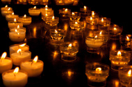 stock-photo-44398620-romantic-glowing-long-row-of-candlelight-burning